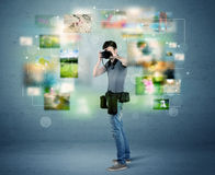Photographer with pictures from the past Royalty Free Stock Image