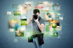 Photographer with pictures from the past Stock Photography
