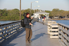 Photographer on pier with camera gear Royalty Free Stock Photography