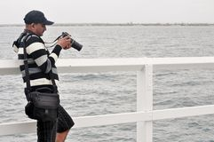 Photographer at Pier Royalty Free Stock Images