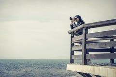 Photographer on the pier. Vintage photo. Stock Photo