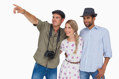 Photographer pointing to something with friends Stock Images