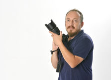 Photographer. Portrait of smiling photographer holding professional camera Stock Images