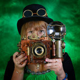 Photographer. Portrait of a steam punk girl with a camera stock images