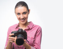Photographer posing with her camera Stock Photo
