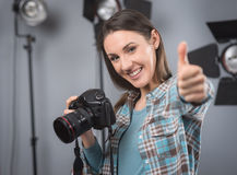 Photographer posing in a professional studio Royalty Free Stock Photos