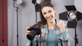 Photographer posing in a professional studio Stock Image