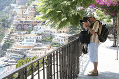 Photographer in Positano, Italy. A tourist taking shots in Positano, Italy. Positano is a village and comune on the Amalfi Coast in Campania, Italy, mainly in an Stock Image