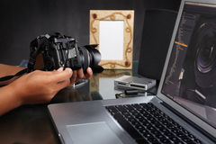 Photographer preparing camera Royalty Free Stock Images