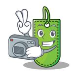 Photographer price tag mascot cartoon. Vector illustration Royalty Free Stock Images