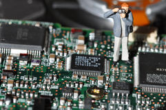 Photographer on printed circuit board Royalty Free Stock Photography