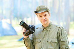 Photographer with professional camera outdoors Stock Photo