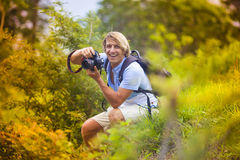 Photographer with Professional Digital Camera Stock Photo