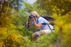 Photographer with Professional Digital Camera Royalty Free Stock Images