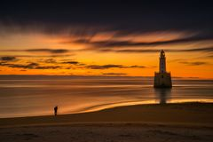 Rattray Head session. Photographer at Rattray Head Lighthouse in sunrise light, east coast of Scotland stock images