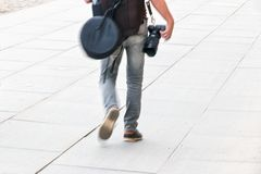 Photographer walking. Photographer ready to take a shot Royalty Free Stock Photography