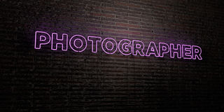 PHOTOGRAPHER -Realistic Neon Sign on Brick Wall background - 3D rendered royalty free stock image Stock Image
