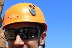 Photographer reflect in sunglasses' mountaineer. Doing a via ferratas in Spain Stock Photos
