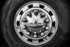 The photographer is reflected in a hubcap - black and white royalty free stock image