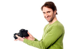 Photographer resetting the camera settings Stock Photos