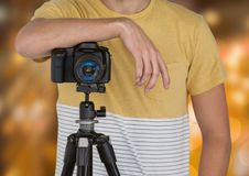 photographer rest on tripod with camera. Blurred city lights back Stock Photo