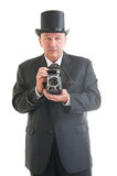 Photographer in a retro business suit Stock Photo