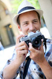 Photographer with retro camera shooting Royalty Free Stock Photos