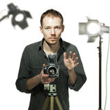 Photographer with retro camera in studio Stock Images