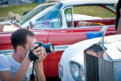 Photographer and retro car Stock Image