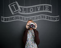 Photographer with retro photo camera Stock Images