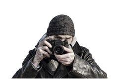 Photographer with retro photo camera isolated on white backgroun Stock Images