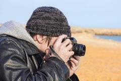 Photographer with retro photo camera taken closeup. Stock Photography