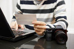 Photographer reviewing the image in the workplace Royalty Free Stock Photos