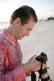 Photographer Reviewing Photos Stock Photography