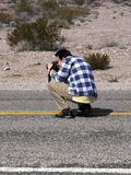 Photographer on the road Royalty Free Stock Photography