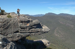 Photographer on rock. Australia, man looking over the Balconies rock formation Stock Photo