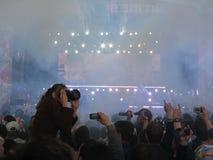 Photographer at rock concert. Woman shooting people at rock concert Royalty Free Stock Photo