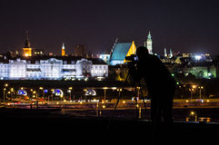 Photographer on the roof in Warsaw Royalty Free Stock Image