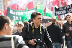 Photographer Rustem Adagamov. MOSCOW, RUSSIA - may 6, 2012:  Photographer Rustem Adagamov at the opposition rally Royalty Free Stock Photo