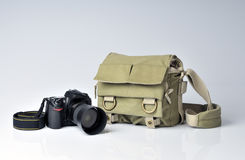 Photographer's bag and SLR Camera Stock Image
