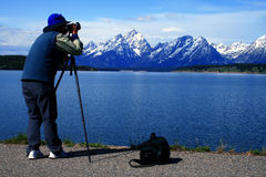 Photographer's Photographer 2. Photographer focused on his subject in Grand Teton National Park Stock Image