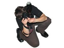 Photographer's pose royalty free stock photography