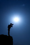 Photographer's shape. On a top of the hill Royalty Free Stock Photo