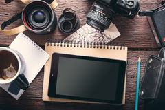 Photographer`s tablet. Tablet on the photographer`s desk, mey photo accessories, cup of tea Stock Photo