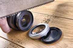 Photographer saws a lens Royalty Free Stock Image
