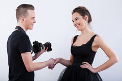 Photographer saying thank you to his model. Photographer saying thank you to his beautiful model Stock Photo