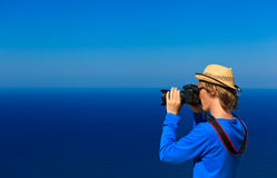 Photographer on sea vacation Royalty Free Stock Image