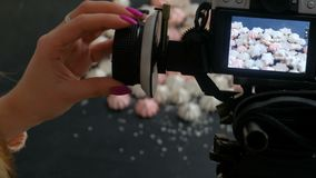 Photographer setting digital camera screen object. Professional photographer setting digital camera to take a photo. objects on the screen. backstage photography stock video footage