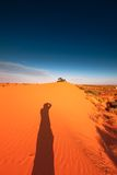 Red sand dune with ripple and blue sky Royalty Free Stock Photography