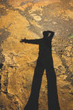 Photographer shadow with rock background Royalty Free Stock Photo